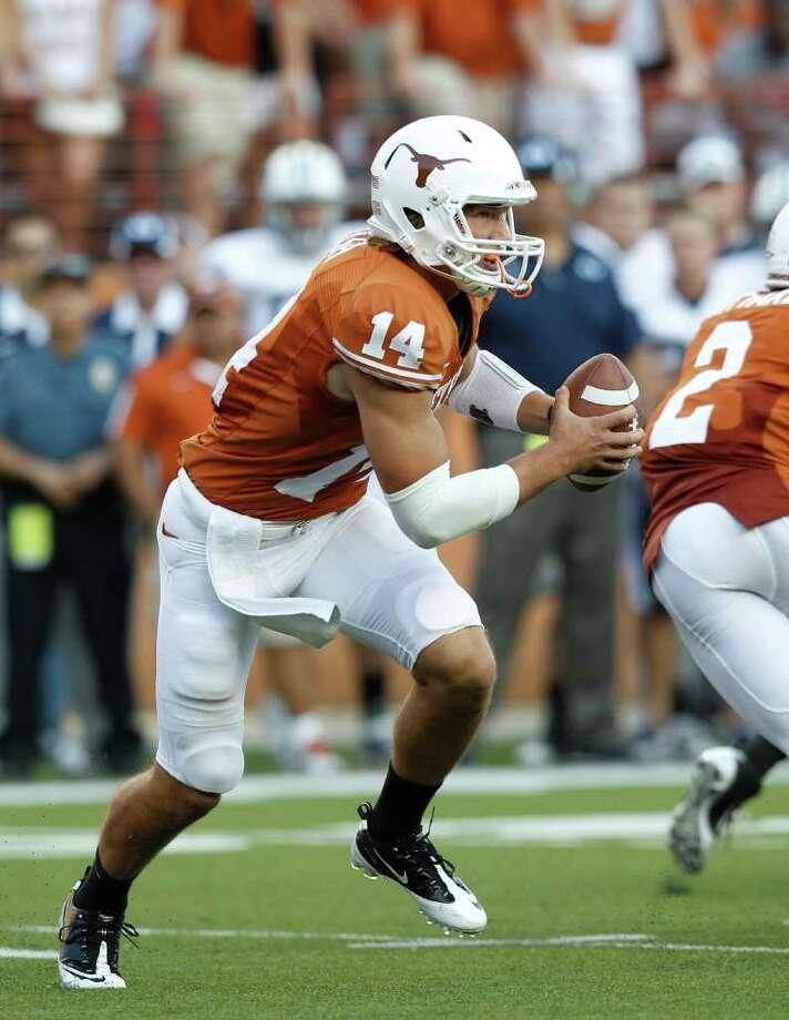 QB SHUFFLE: Freshman David Ash is part of UT's one-two punch at quarterback. Photo: Eric Gay / AP