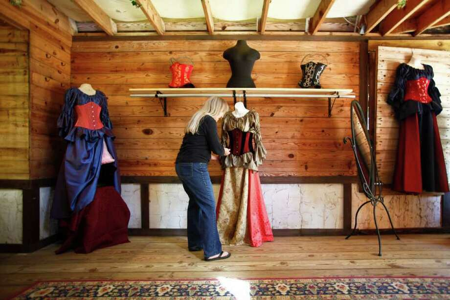 Nancy Brite-Smith dresses a mannequin at her shop, Scarlett's Corset, while prepping for the upcoming Texas Renaissance Festival. Photo: Michael Paulsen, Houston Chronicle / © 2011 Houston Chronicle