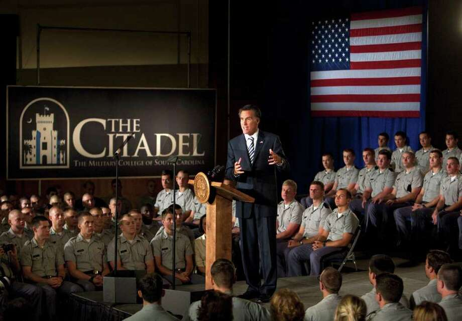 """MIC SMITH : ASSOCIATED PRESS  ATTENTIVE AUDIENCE: Republican presidential candidate Mitt Romney told Citadel cadets and supporters that """"this is America's moment"""" during a campaign stop at the Charleston, S.C., campus on Friday. Photo: Mic Smith / Copyright 2011 The Associated Press. All rights reserved. This material may not be published, broadcast, rewritten or redistribu"""