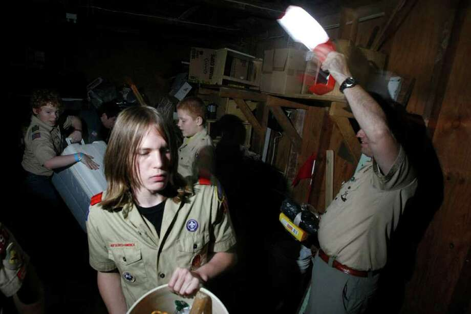 Boy Scout Russell Williams, 15, packs on Thursday at St. Philip's United Methodist Church before Troop 197 heads to Camp Brosig in Sealy for a camping weekend.  A burn ban will prevent them from building any campfires. Photo: Johnny Hanson / © 2011 Houston Chronicle