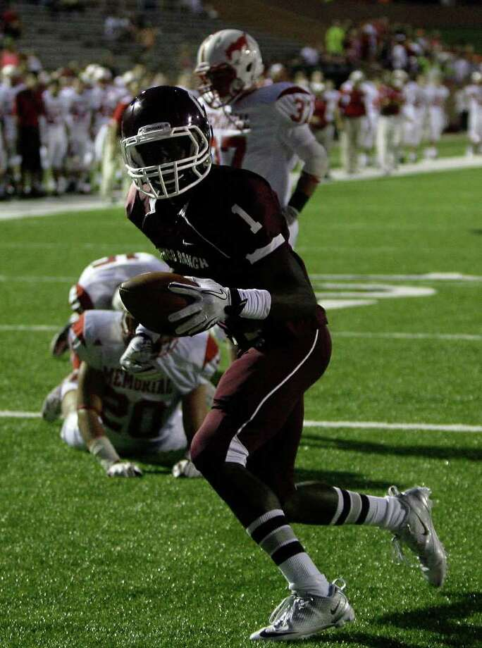 Cinco Ranch 17, Memorial 0. Cinco Ranch High School's James Rhoden (1) scores a touchdown during the first quarter of a football game against Memorial High School Friday, Oct. 7, 2011, in Katy. Photo: Cody Duty, Houston Chronicle / © 2011 Houston Chronicle