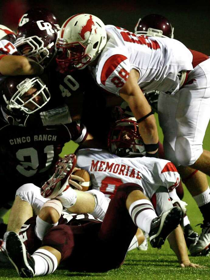Memorial High School running back Boomer White (8) is brought down by the Cinco Ranch High School defense during the second half of a football game at Rhodes Stadium Friday, Oct. 7, 2011, in Katy. Photo: Cody Duty, Houston Chronicle / © 2011 Houston Chronicle