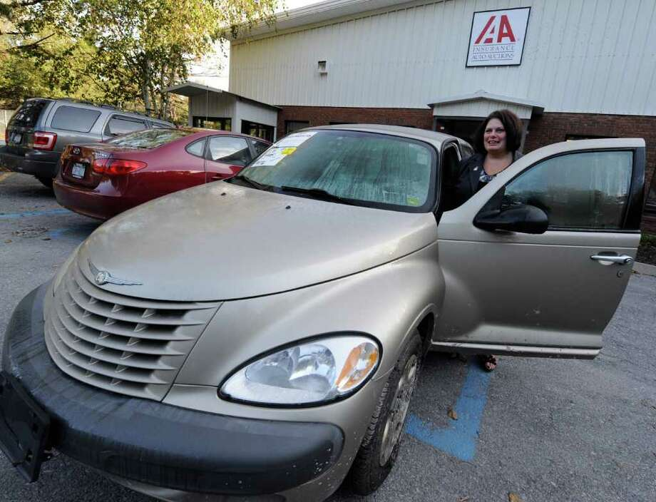 Carol Lafleur, Executive Director of the Northeast Kidney Foundation stands with the donated car for local kidney foundation October 7, 2011. The car is presently housed at Insurance Auto Auctions in Schenectady, N.Y.   (Skip Dickstein/Times Union) Photo: Skip Dickstein / 2011