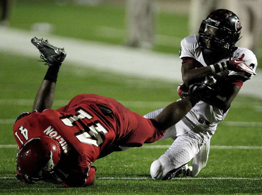 Port Arthur Memorial's Jaylon Howard, right, tackles North Shore's Davonte Milton in the second quarter as North Shore High School played Port Arthur Memorial High School at Galena Park ISD District Athletic Complex Friday, Oct. 7, 2011, in Houston. Photo: Johnny Hanson, Houston Chronicle / © 2011 Houston Chronicle
