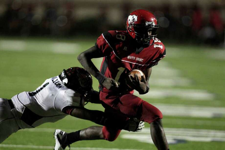 Oct. 7: North Shore vs. Port Arthur  Memorial. North Shore's Micah Thomas (18) runs through the tackle of Port Arthur Memorial's Davonte McMillian, left in the second quarter as North Shore High School played Port Arthur Memorial High School at Galena Park ISD District Athletic Complex Friday, Oct. 7, 2011, in Houston. Photo: Johnny Hanson, Houston Chronicle / © 2011 Houston Chronicle