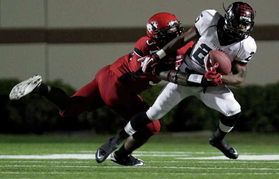 Port Arthur Memorial's Kenneth Mayfield, right, is tackled by North Shore's  Jarius Moore, left, in the first quarter as North Shore High School played Port Arthur Memorial High School at Galena Park ISD District Athletic Complex Friday, Oct. 7, 2011, in Houston. Photo: Johnny Hanson, Houston Chronicle / © 2011 Houston Chronicle