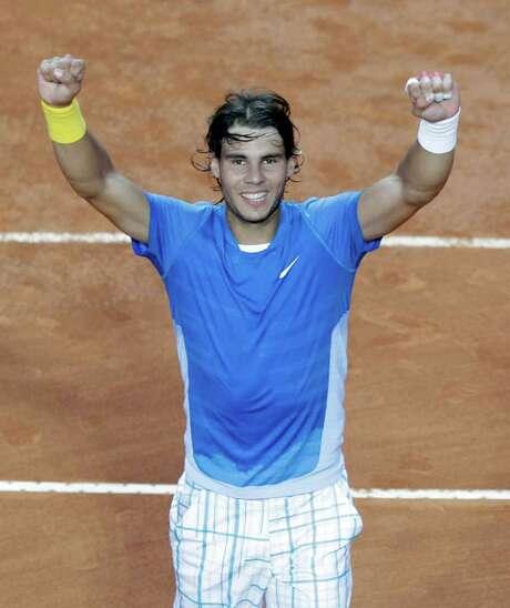Rafael Nadal of Spain celebrates after beating Stanislas Wawrinka of Switzerland at the Rome Masters tennis tournament, in Rome, Friday, April 30, 2010. Nadal beat  Wawrinca 6-4, 6-1. (AP Photo/Alessandra Tarantino) Photo: ALESSANDRA TARANTINO / AP