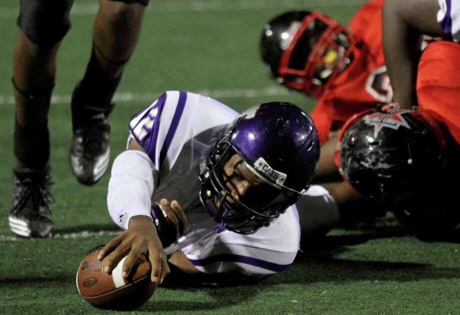 10/7/11:  Quarterback T. J. Austin #12 of the Angleton Wildcats reaches for a first down against the Terry Rangers in a class 4A District 23-4A football game in Rosenberg, Texas. For the Chronicle: Thomas B. Shea Photo: For The Chronicle: Thomas B. She