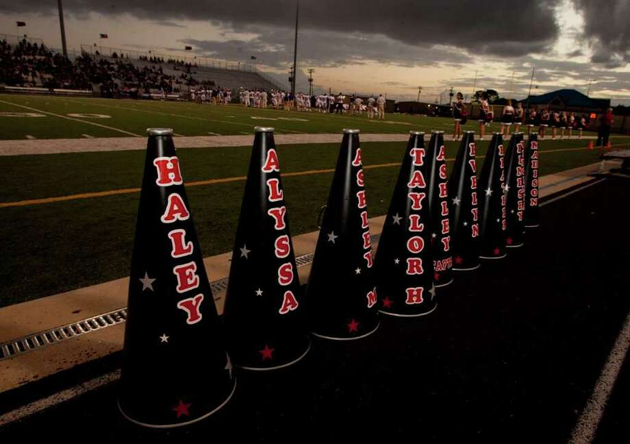 Ranger cheerleader megaphones sit on the track before a storm hit before the Terry Rangers played against  the Angleton Wildcats  in a class 4A District 23-4A football game in Rosenberg, Texas. For the Chronicle: Thomas B. Shea Photo: For The Chronicle: Thomas B. She
