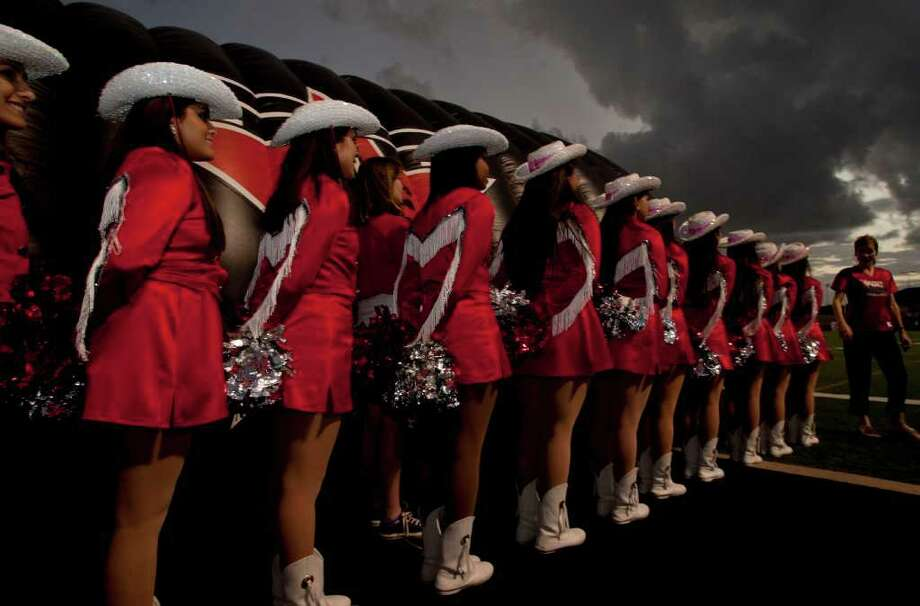 Ranger Rangerettes line up cheerleader before a storm hit before the Terry Rangers played against  the Angleton Wildcats  in a class 4A District 23-4A football game in Rosenberg, Texas. For the Chronicle: Thomas B. Shea Photo: For The Chronicle: Thomas B. She