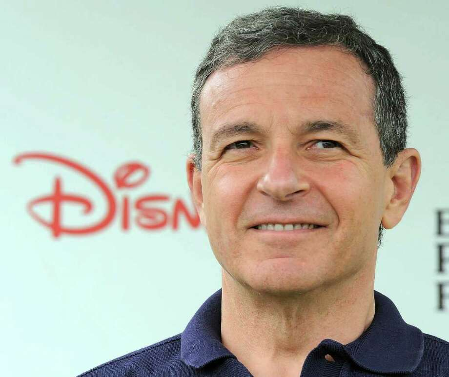 This June 12, 2011 photo shows Robert Iger arriving at The 22nd Annual A Time for Heroes Celebrity Carnival Sponsored by Disney at Wadsworth Theater in Los Angeles. Iger will remain in his job through March 2015 and then serve as executive chairman for another 15 months to help break in a new chief executive, according to an announcement Friday Oct. 7, 2011.    (AP Photo/Katy Winn) Photo: Katy Winn / AP2011