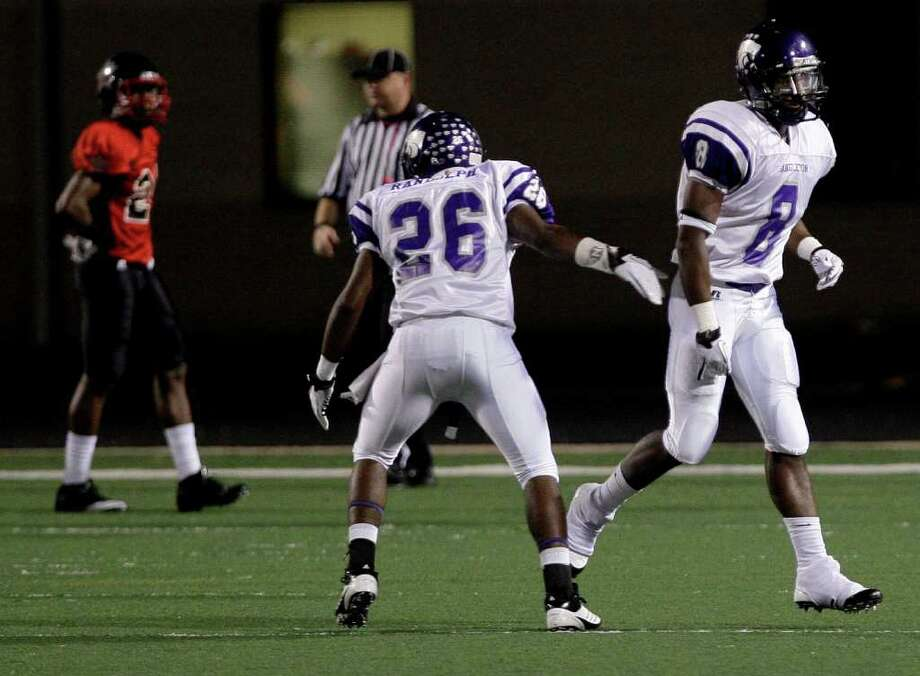 Running back Ryan Jackson #8 celebrates his rushing touchdown with Brad Randolph #26 of the Angleton Wildcats against the Terry Rangers in a class 4A District 23-4A football game in Rosenberg, Texas. For the Chronicle: Thomas B. Shea Photo: For The Chronicle: Thomas B. She