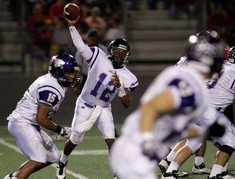 Quarterback T. J. Austin #12 of the Angleton Wildcats completes a pass against the Terry Rangers in