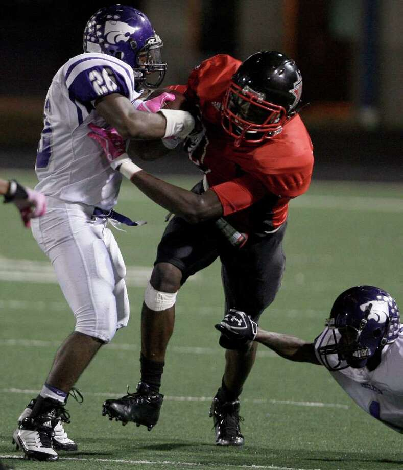 Wide receiver Derrick Griffin #80 of the Terry Rangers makes a catch and breaks the tackle of Brad Randolph #26 and Scott Gerard #1 of the Angleton Wildcats  in a class 4A District 23-4A football game in Rosenberg, Texas. For the Chronicle: Thomas B. Shea Photo: For The Chronicle: Thomas B. She