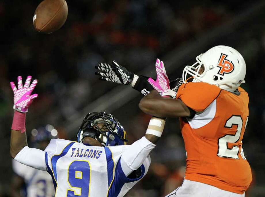 Chanelview High School's Robbie Miller (9), left, breaks up a pass intended for La Porte High SChool's Keith Whitely in the first quarter of a District 21-5A football game at Bulldog Stadium on Friday, Oct. 7, 2011, in La Porte. Photo: Nick De La Torre, Houston Chronicle / © 2011  Houston Chronicle