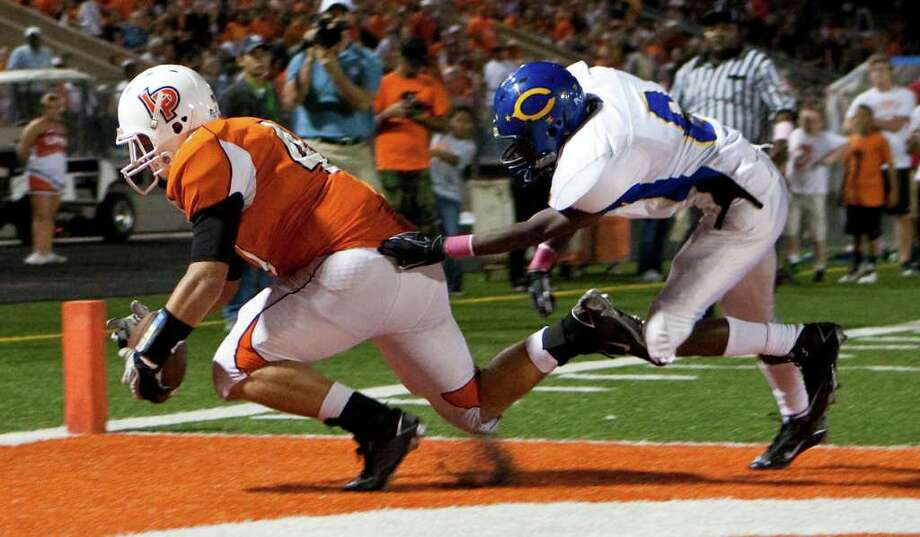 La Porte High Schol's Trevor Nelson (47), left, pulls in the ball for a touchdown as Channelview High SChool's Brandon Thomas (6) tries to defend in the second quarter of a District 21-5A football game at Bulldog Stadium on Friday, Oct. 7, 2011, in La Porte. Photo: Nick De La Torre, Houston Chronicle / © 2011  Houston Chronicle