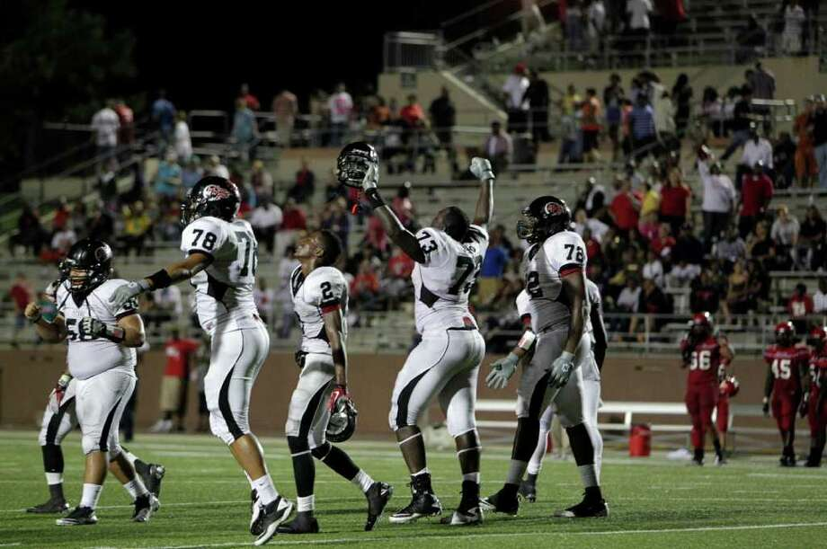 Port Arthur Memorial players celebrate as they defeated North Shore High School 14-7 at Galena Park ISD District Athletic Complex Friday, Oct. 7, 2011, in Houston. Photo: Johnny Hanson, Houston Chronicle / © 2011 Houston Chronicle