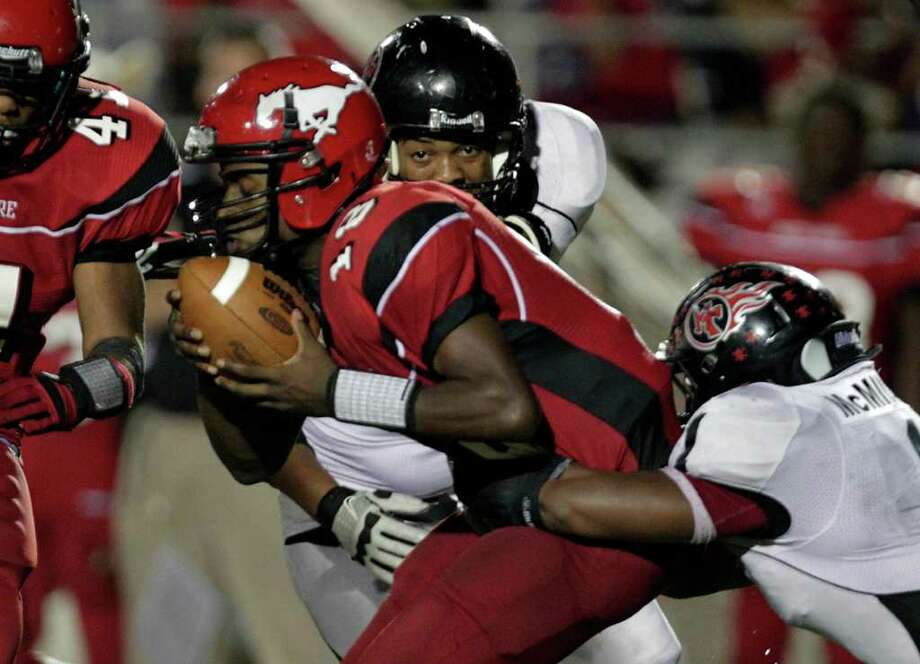 2. Port Arthur Memorial (6-0)Rushing yards allowed per game: 107.5.Passing yards allowed per game: 37.3.Total yards allowed per game: 144.8.Points allowed per game: 11.1. - The Titans' defense had its most impressive performance of the season last week, limiting North Shore to seven points. Photo: Johnny Hanson, Houston Chronicle / © 2011 Houston Chronicle