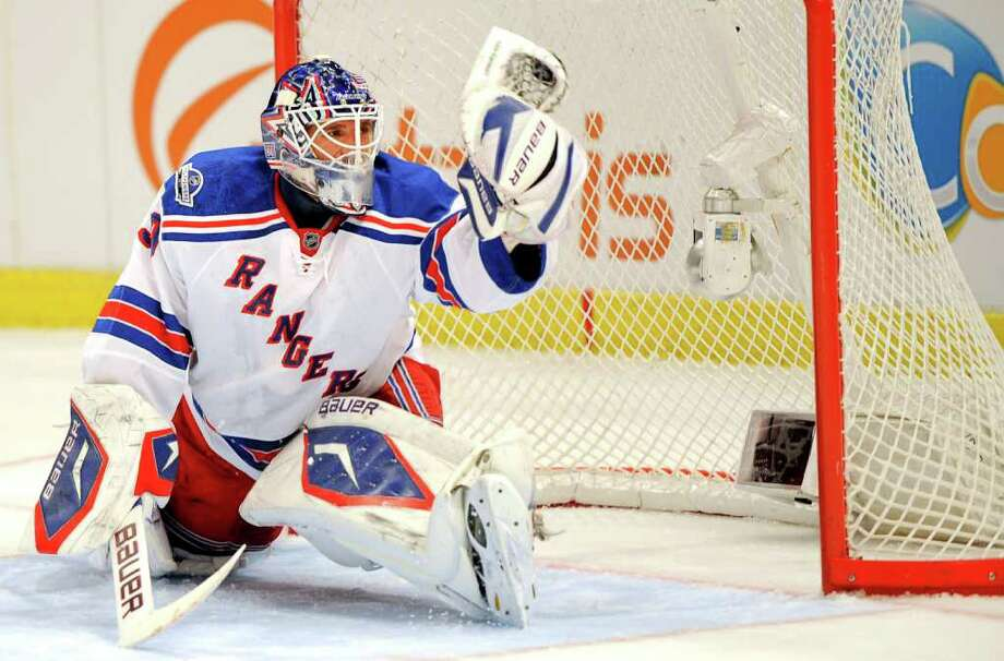 NIKLAS LARSSON : ASSOCIATED PRESS WELCOME HOME: Rangers goalie Henrik Lundqvist snatches the puck from the air Friday against the Kings in  his native Sweden. Lundqvist and the Rangers lost in overtime 3-2. Photo: Niklas Larsson / AP