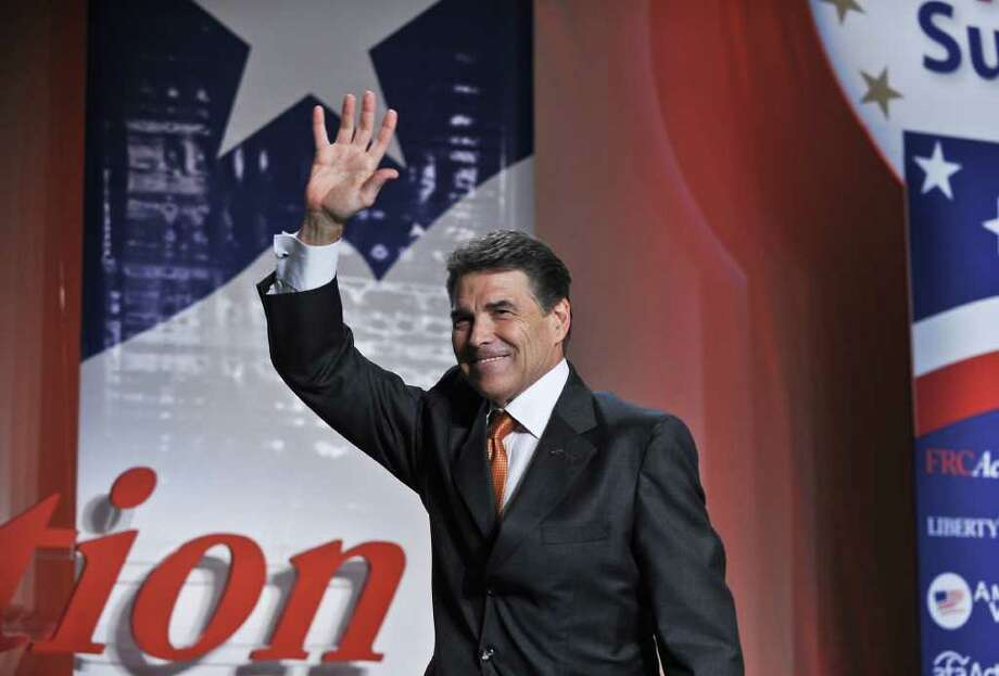 Republican presidential hopeful Texas Gov. Rick Perry waves after addressing the Family Research Council's Values Voter Summit in Washington,DC on October 7, 2011.    AFP PHOTO/Nicholas KAMM (Photo credit should read NICHOLAS KAMM/AFP/Getty Images) Photo: NICHOLAS KAMM