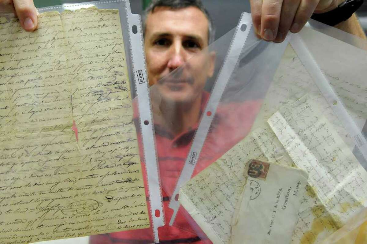 Jim Gandy, assistant librarian at the New York State Military Museum and Veterans Research Center, holds letters written by Carlos Alvarez de la Mesa on Thursday, Oct. 6, 2011 in Saratoga Springs. The museum has about 200 Civil War letters and documents pertaining to his service. Carlos Alvarez de la Mesa was a Spainaird who came to the U.S. to fight in the Civil War. (Paul Buckowski / Times Union)