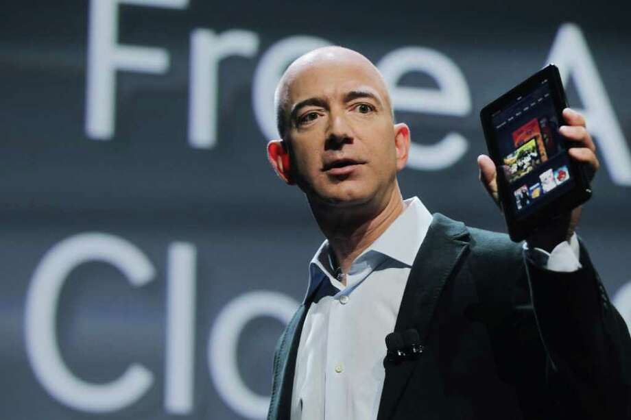 Spencer Platt : Getty Images APPLE RIVAL: Amazon.com founder Jeff Bezos displays the new Amazon tablet called the Kindle Fire. It could become the iPad's first credible challenger for market share. Photo: Spencer Platt / 2011 Getty Images
