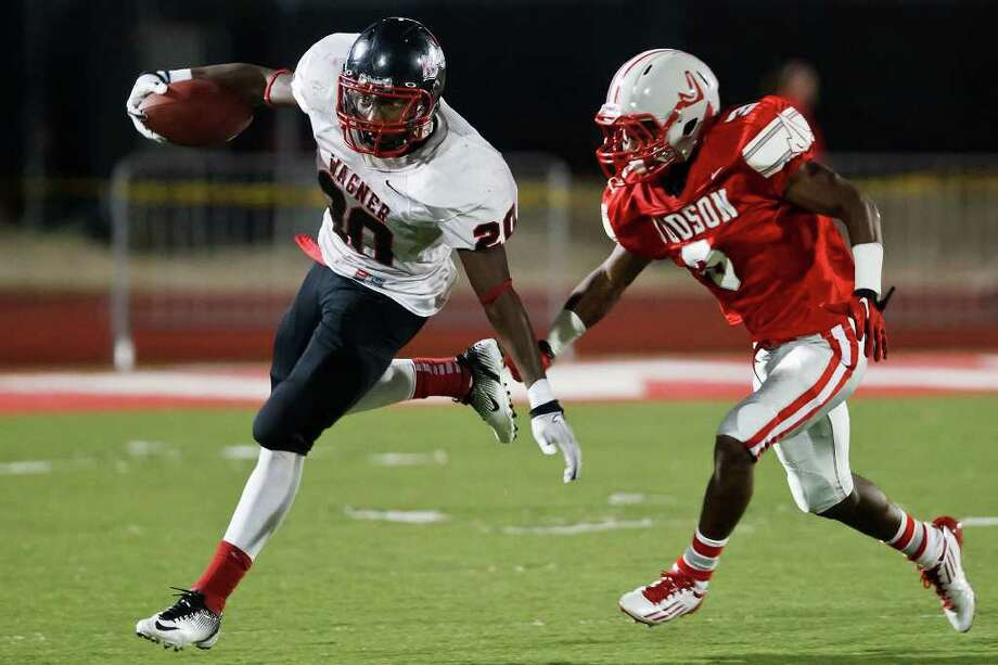 Wagner running back Derrick Kindred tries to elude Judson's Michael Williams during their game at Rutledge Stadium on Oct. 7, 2011.   Kindred led all rushers with 153-yards and a touchdown to help lead the Thunderbirds to a 20-10 victory. MARVIN PFEIFFER/mpfeiffer@express-news.net Photo: MARVIN PFEIFFER, Marvin Pfeiffer/Express-News / Express-News 2011