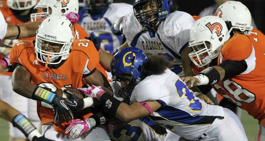 La Porte High School's Keith Whitely (21) looks to break away from Channelview High School's Anthony bush (34) and the rest of the Falcon defense in the third  quarter of a District 21-5A football game at Bulldog Stadium on Friday, Oct. 7, 2011, in La Porte. La Porte won 35-21. Photo: Nick De La Torre, Houston Chronicle / © 2011  Houston Chronicle