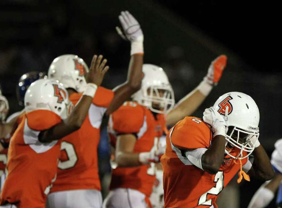 La Porte High School's Ellis Hutchinson (2), front, and the rest of the kick off team celebrate after they recovered a fumble in the fourth quarter of a District 21-5A football game against Channelview High School at Bulldog Stadium on Friday, Oct. 7, 2011, in La Porte. La Porte won 35-21. Photo: Nick De La Torre, Houston Chronicle / © 2011  Houston Chronicle