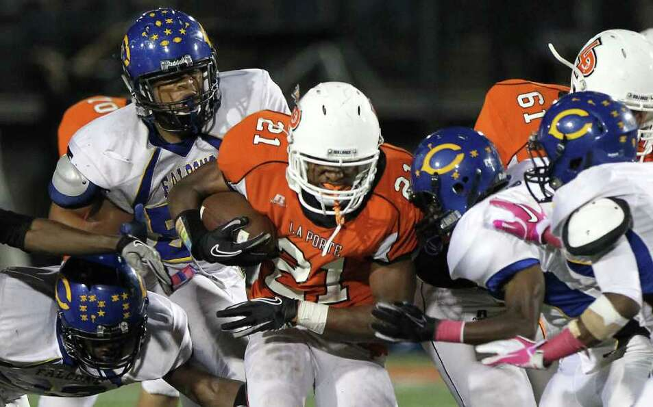 The Channelview High School key in on La Porte High School's Keith Whitely in the fourth quarter of