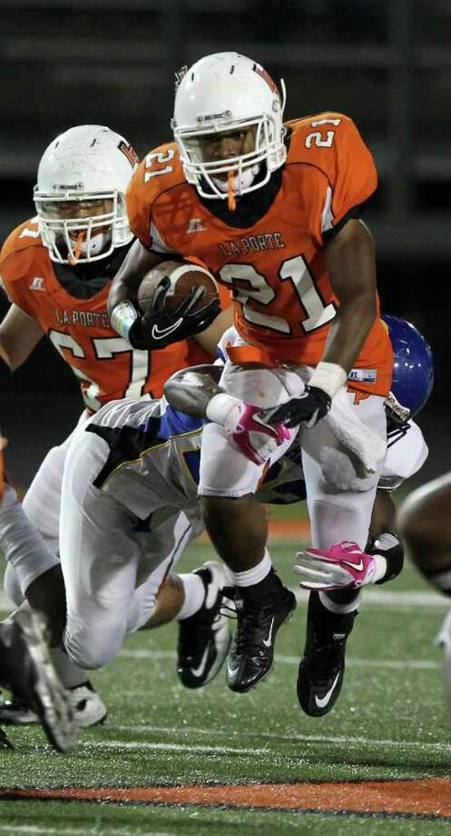 La Porte High School's Keith Whitely tries to break away from Channelview High School's Devin Philips in the third quarter of a District 21-5A football game at Bulldog Stadium on Friday, Oct. 7, 2011, in La Porte. La Porte won 35-21. Photo: Nick De La Torre, Houston Chronicle / © 2011  Houston Chronicle