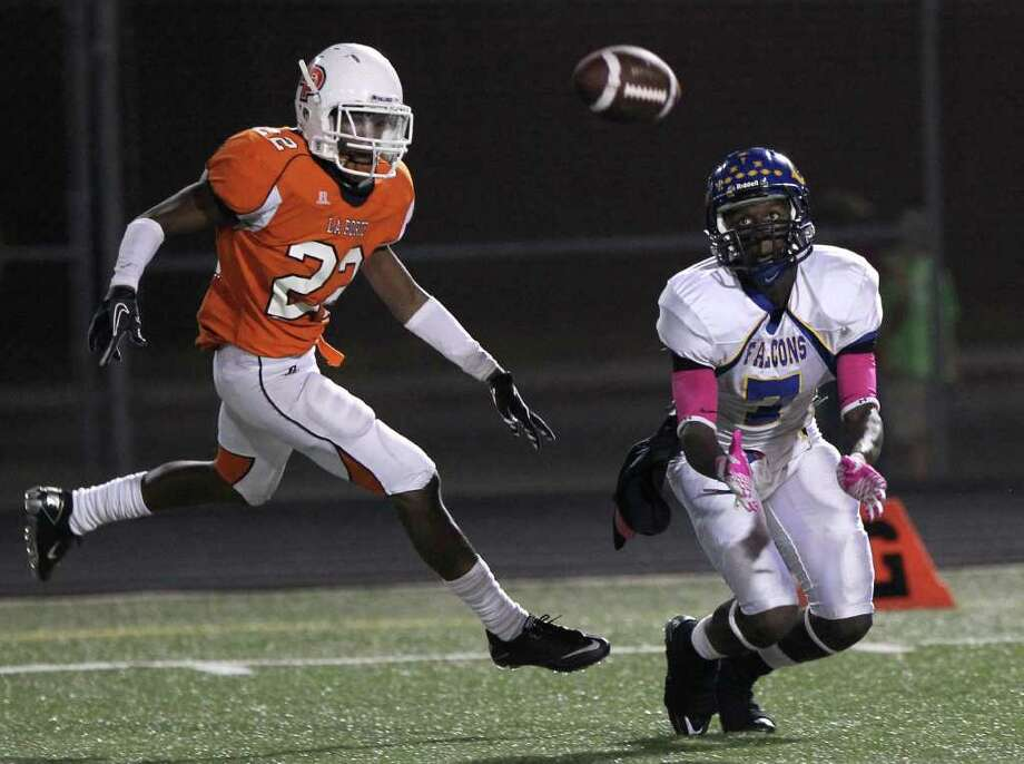 Channelview High School's Marquise Johnson (7) is not able to pull a ball in for a reception as La Porte High School's Malik Graves tries to recover in the third quarter of a District 21-5A football game at Bulldog Stadium on Friday, Oct. 7, 2011, in La Porte. La Porte won 35-21. Photo: Nick De La Torre, Houston Chronicle / © 2011  Houston Chronicle