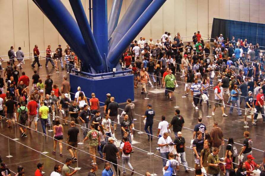 Fans filter in to the UFC Fan Expo at the George R. Brown Convention Center, Friday, Oct. 7, 2011, i