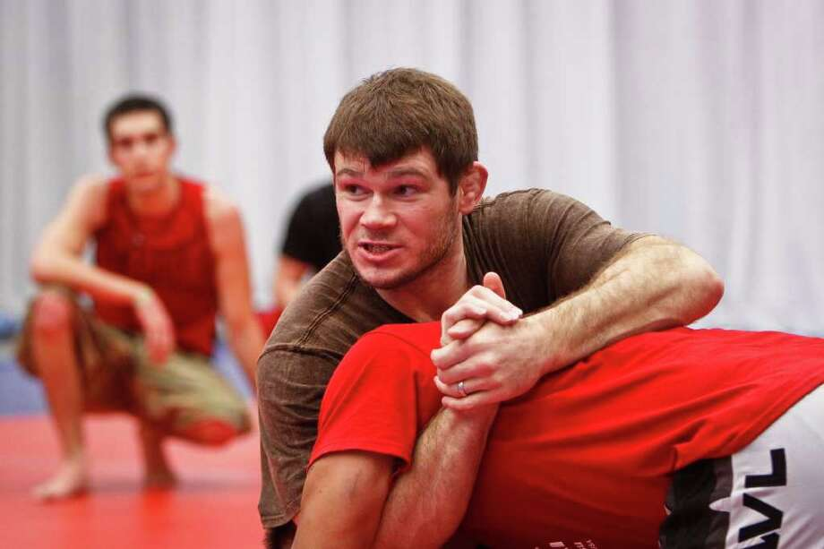 UFC fighter Forrest Griffin (center) gives instructions to students during a Training and Development Session at the UFC Fan Expo at the George R. Brown Convention Center, Friday, Oct. 7, 2011, in Houston. Photo: Michael Paulsen, Houston Chronicle / © 2011 Houston Chronicle