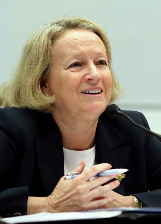 Mary Schapiro, chairman of the Securities and Exchange Commission, testifies before members of the House Financial Services and Oversight and Government Reform committees in Washington, D.C., U.S., on Thursday, Sept, 22, 2011. Lawmakers grilled Schapiro over what they called a breakdown in ethics that allowed the agency's former top lawyer to work on policy related to the Bernard Madoff fraud after he inherited money from the Ponzi scheme. Photographer: Chris Kleponis/Bloomberg *** Local Caption *** Mary Schapiro Photo: Chris Kleponis / © 2011 Bloomberg Finance LP