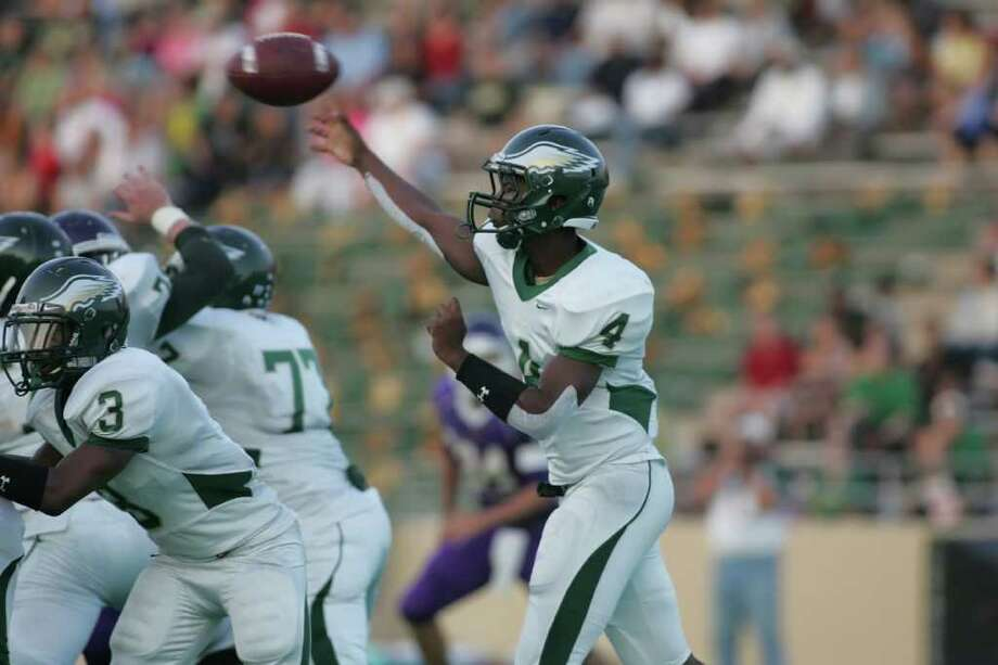 L. SCOTT HAINLINE: FOR THE CHRONICLE LETTING IT FLY: Cy Falls quarterback Troy Mitchell will try to keep the Eagles undefeated when they meet Langham Creek today. Photo: Matthew White / Freelance