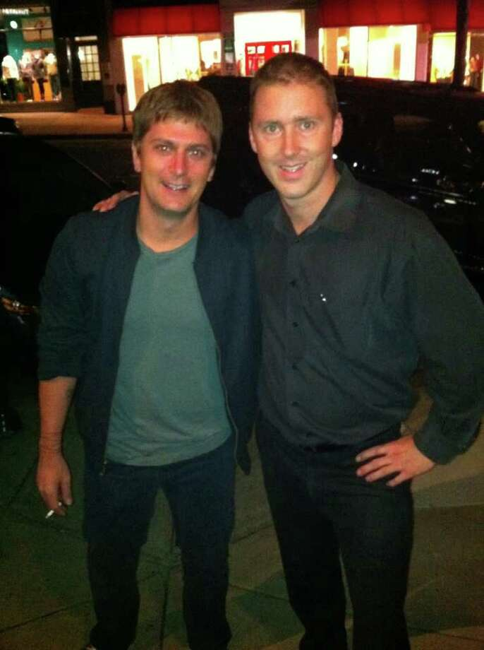 Matchbox Twenty lead singer Rob Thomas, left, poses with Maxime de Givenchy, assistant manager at Terra Ristorante, on Greenwich Avenue. Photo: Contributed Photo
