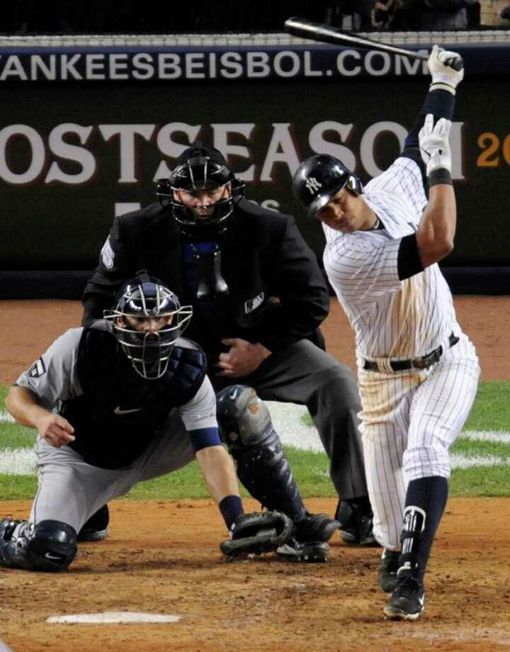New York Yankees' Alex Rodriguez strikes out with bases loaded as Detroit Tigers catcher Alex Avila and umpire Ted Barrett look on in the seventh inning during Game 5 of baseball's American League division series Thursday, Oct. 6, 2011, at Yankee Stadium in New York. The Tigers won 3-2. (AP Photo/Bill Kostroun) Photo: Bill Kostroun