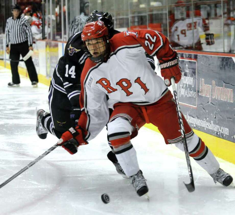 RPI'S C.J. Lee (22), right, battles for a loose puck with Minnesota State's Justin Jokinen (14) during their hockey game on Friday, Oct. 7, 2011, at Rensselaer Polytechnic Institute in Troy, N.Y. (Cindy Schultz / Times Union) Photo: Cindy Schultz