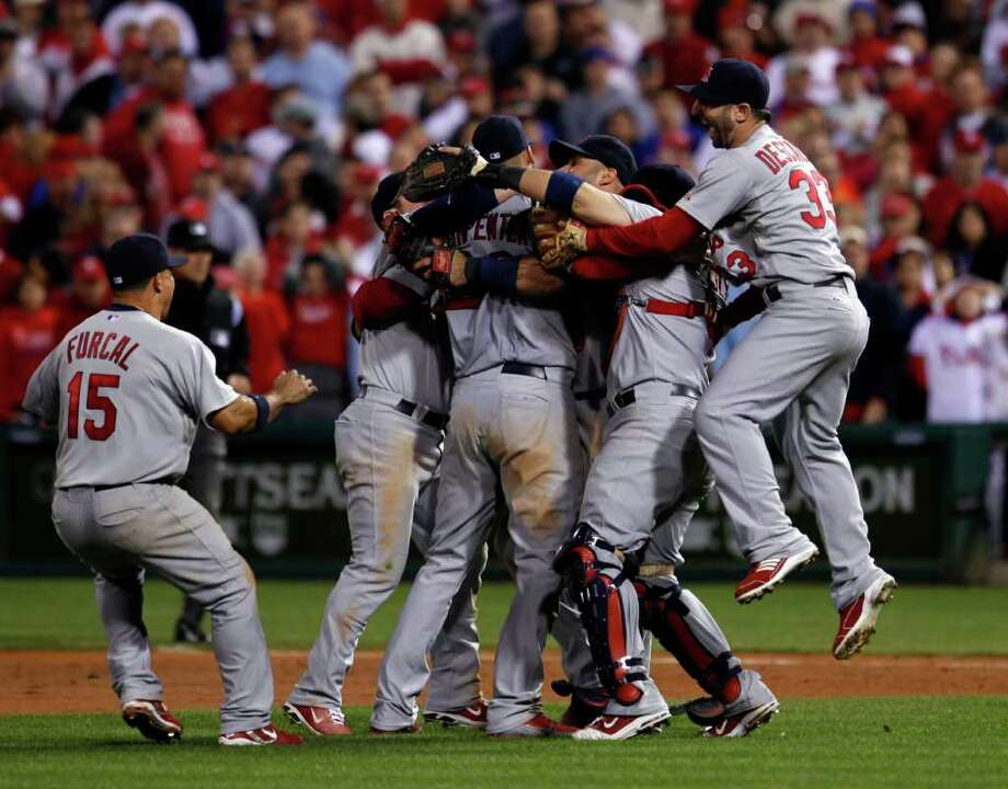 The St. Louis Cardinals react after winning with a score of 1-0, baseball's Game 5 of the National League division series with the Philadelphia Phillies Friday, Oct. 7, 2011 in Philadelphia. (AP Photo/Alex Brandon) Photo: Alex Brandon