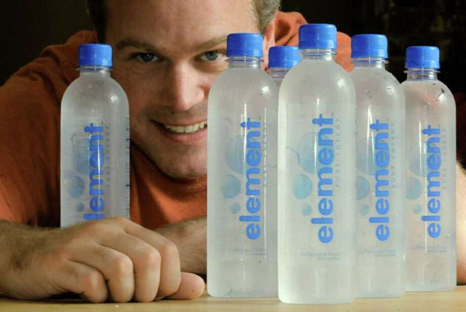 Steve Gilbank is the founder of Element caffeinated water in Saratoga Springs, NY Thursday July 21,2011.( Michael P. Farrell/Times Union) Photo: Michael P. Farrell / 00013996A