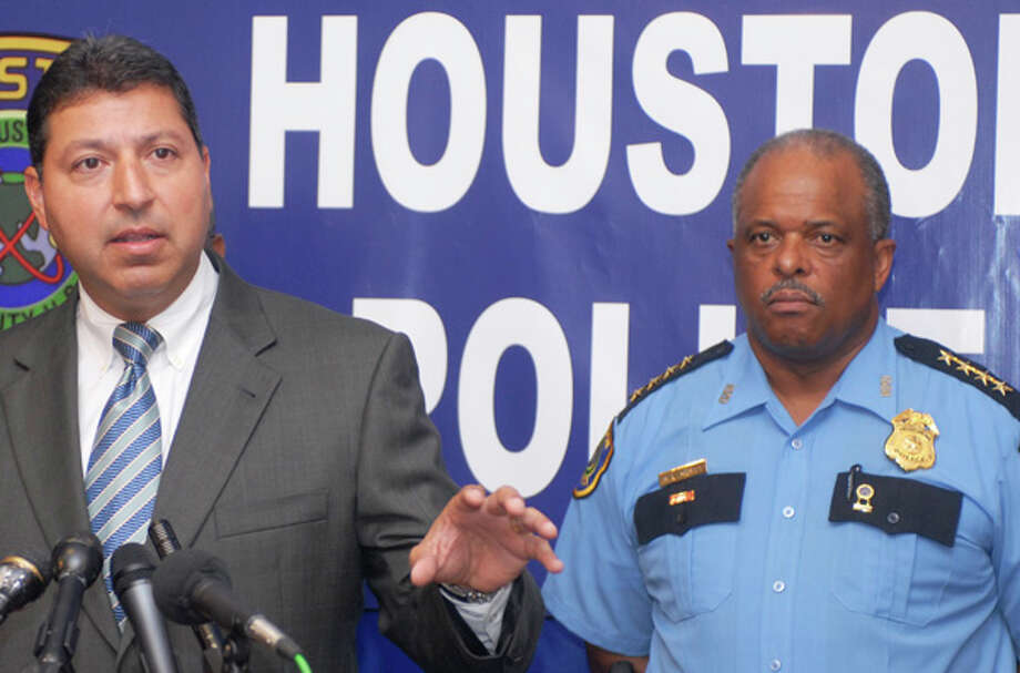 Houston Assistant Police Chief Daniel S. Perales, shown with Chief Harold Hurtt at a news conference in August 2006, in the next  two weeks will be transferred to the Northeast Patrol  Command, which  includes management of the DWI task force. Photo: Carlos Javier Sanchez, For The Houston Chronicle / Freelance