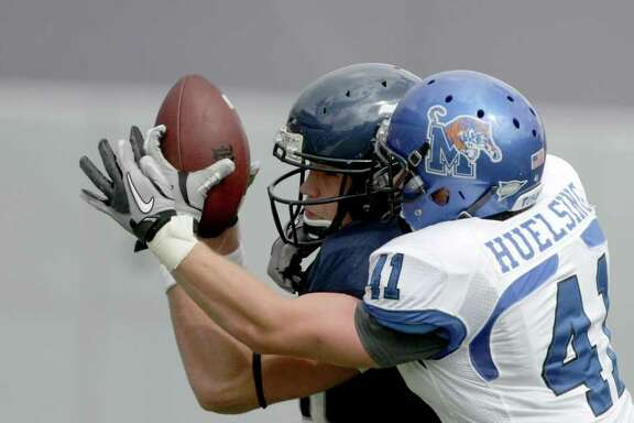 Rice University wide receiver Vance McDonald (88) pulls in a pass as Memphis University defensive back Mitch Huelsing (41) tries to defend in the first quarter of a NCAA football game at Rice Stadium on Saturday, Oct. 8, 2011, in Houston.