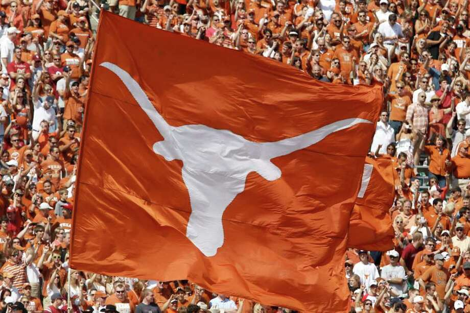 The Texas Longhorn flag during the NCAA college football game at the Cotton Bowl in Dallas, Saturday, Oct. 8, 2011.  (AP Photo/Brandon Wade) Photo: Brandon Wade, Associated Press / FR168019 AP