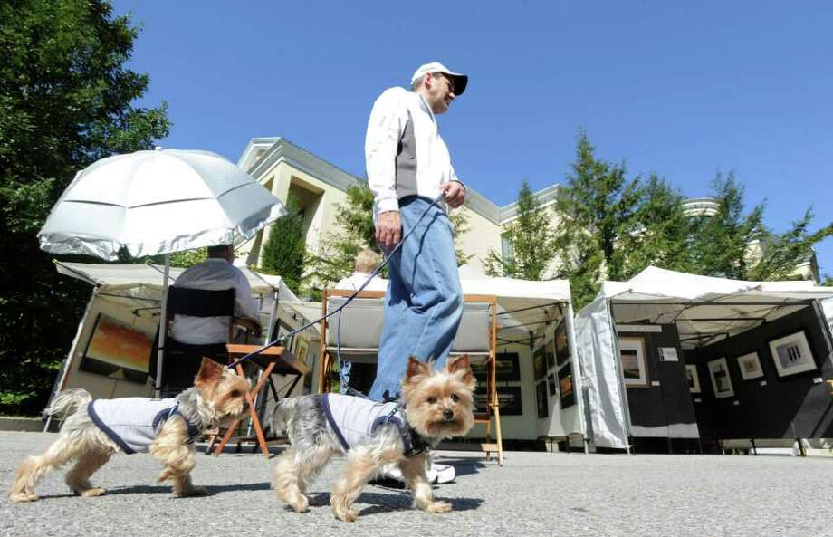 Lou Amicucci of Stamford and his Yorkshire terriers, Dante and Dylan, left to right, during the 30th annual Outdoor Arts Festival at the Bruce Museum in Greenwich, Saturday morning, Oct. 8, 2011. The festival runs Sunday from 10 a.m. to 5 p.m. on the museum grounds at 1 Museum Drive. Photo: Bob Luckey / Greenwich Time