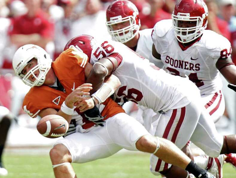 Oct. 8: Oklahoma 55, Texas 17 Texas quarterback David Ash fumbles the