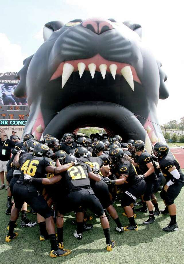10/8/11: The Klein Oak Panthers get fired up before playing against  the Dekaney Wildcats in a high school football game at Klein Memorial Stadium in Klein, Texas. For the Chronicle: Thomas B. Shea Photo: For The Chronicle: Thomas B. She