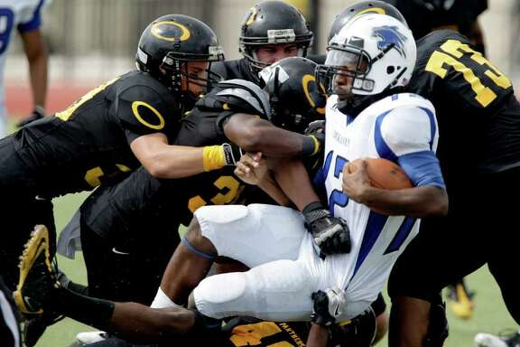 10/8/11: Quarterback D'Juan Hines #12 of the Dekaney Wildcats is tackled by the Klein Oak Panthers defense  in a high school football game at Klein Memorial Stadium in Klein, Texas. For the Chronicle: Thomas B. Shea