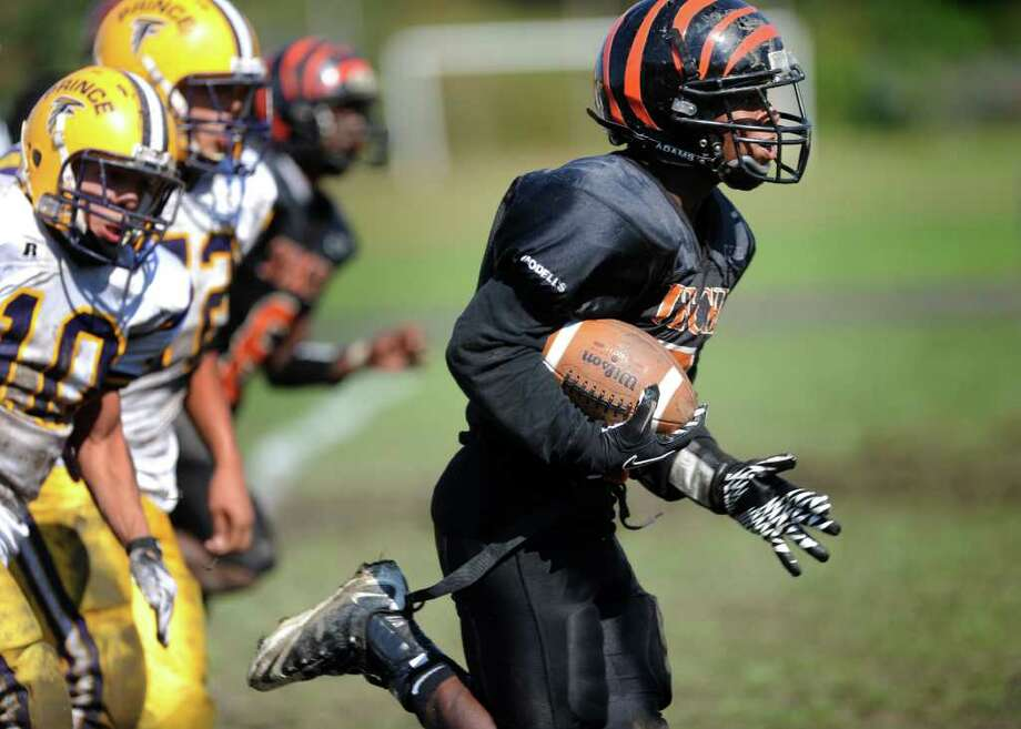 Bullard-Havens Technical School's Equan Brooks runs for a touchdown on a punt return during their game against Prince Tech, of Hartford, Saturday, Oct. 8, 2011 at Bullard-Havens' campus in Bridgeport, Conn. Photo: Autumn Driscoll