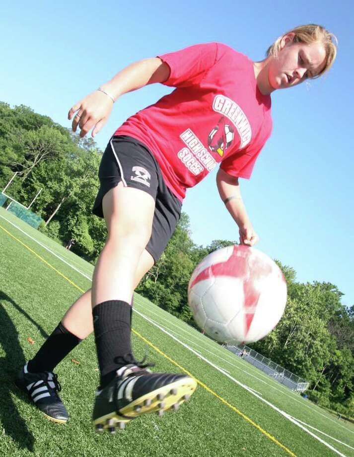 Greenwich High School soccer player Shannon Colligan works on her ball- handling skills Friday morning, July 15, 2011, at GHS in preparation for the upcoming season. Photo: David Ames/For Greenwich Time / Greenwich Time